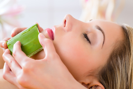 Wellness - woman having aloe vera application