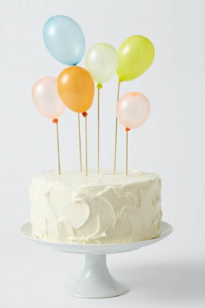 como decorar un pastel con globos